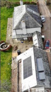 Zoomed out aerial view of a house under construction